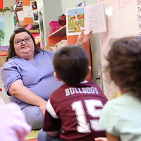 "Adam Robison | BUY AT PHOTOS.DJOURNAL.COM<br /> Jeannie Doler, PreSchool teacher at The Kangaroo's Patch Day Care Center in Pontotoc, reads ""Caps for Sale"" by Esphyr Slobodkina to her students Wednesday morning in Pontotoc."