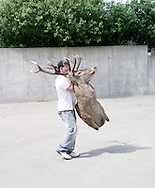 A white tailed deer is beeing carried into the show by an unknown man