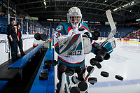 KELOWNA, CANADA - FEBRUARY 6: Roman Basran #30 of the Kelowna Rockets throws the pucks to the ice for warm up against the Spokane Chiefs on February 6, 2019 at Prospera Place in Kelowna, British Columbia, Canada.  (Photo by Marissa Baecker/Shoot the Breeze)
