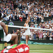 LONDON, ENGLAND - JULY 15:  Garbine Muguruza of Spain, celebrates her victory in the Ladies Singles final  watched by Venus Williams of The United States during the Wimbledon Lawn Tennis Championships at the All England Lawn Tennis and Croquet Club at Wimbledon on July 15, 2017 in London, England. (Photo by Tim Clayton/Corbis via Getty Images)