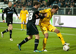 14.12.2011, UPC Arena, Graz, AUT, UEFA Europa League , Sturm Graz vs AEK Athen FC, im Bild Roger Guerreiro (AEK Athen FC, Midfield, #7) und Joachim Standfest (SK Puntigamer Sturm Graz, #18) // during UEFA Europa League football game between Sturm Graz and AEK Athens FC at UPC Arena in Graz, Austria on 14/12/2011. EXPA Pictures © 2011, PhotoCredit: EXPA/ E. Scheriau