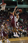 Chris Thomas of TSU goes up over Arthur Wade a Alabama A&M defender. TSU defeats Alabama A&M 77-54 at the HP&E Arena in Houston, Texas. Photo By: Jerome Hicks/ Space City Images