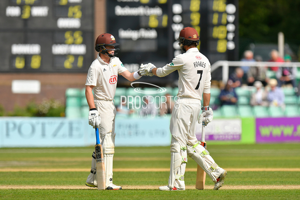 Ollie Pope of Surrey and Ben Foakes of Surrey touch gloves during the final day of the Specsavers County Champ Div 1 match between Worcestershire County Cricket Club and Surrey County Cricket Club at New Road, Worcester, United Kingdom on 13 September 2018.