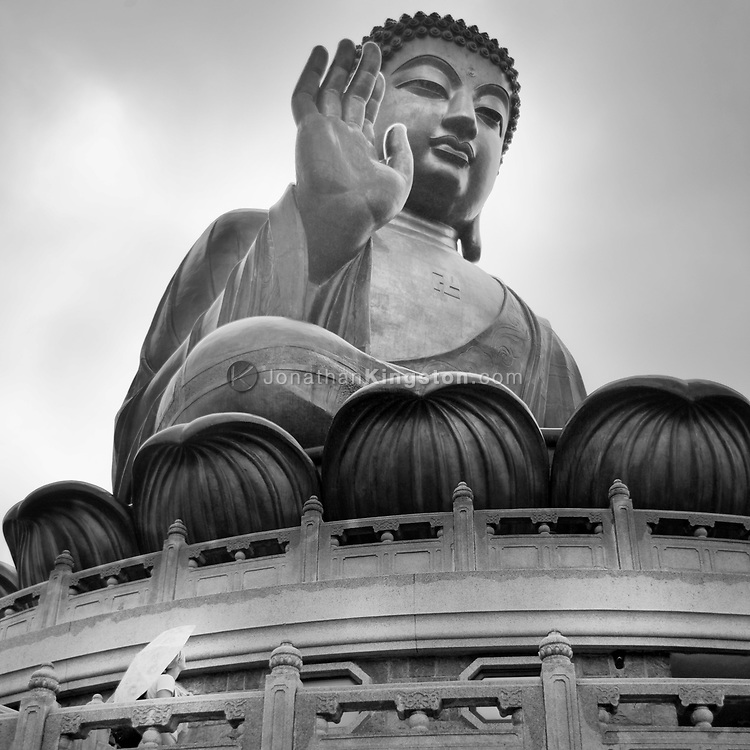 The Tian Tan Buddha, the world's largest outdoor seated bronze Buddha, Lantau Island, Hong Kong, China.  Lantau Island is a major center of Buddhism in Hong Kong, and is also a popular tourist attraction.  Hong Kong Special Administrative Region is one of two special administrative regions of the People's Republic of China.