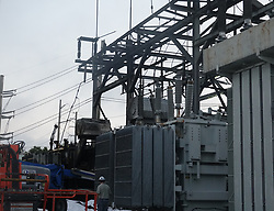 March 27, 2019 - Fort Lauderdale, FL, USA - FPL workers are seen at the charred Sistrunk substation, Wednesday, March 27, 2019, in Fort Lauderdale, Fla. (Credit Image: © Joe Cavaretta/Sun Sentinel/TNS via ZUMA Wire)