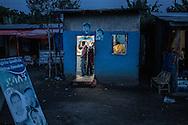 Barber shop at dusk on the main highway in Shashemene, Ethiopia.