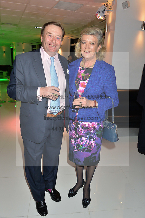 Trainer NICKY HENDERSON and his wife at the London premier of Being AP held at Altitude 360, Millbank Tower, 30 Millbank, London on 23rd November 2015.