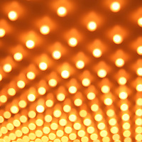 Picture of casino lights in rows blurred out of focus at an angle. This style of lighting is commonly known as casino lights, theater lights or Broadway lights. Image is high resolution and is available as a stock photo, poster or print.