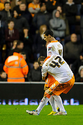 Blackpool Midfielder Thomas Ince (ENG) is hugged by Defender Kirk Broadfoot (SCO) after soring his sides winning goal during the second half of the match - Photo mandatory by-line: Rogan Thomson/JMP - Tel: Mobile: 07966 386802 26/01/2013 - SPORT - FOOTBALL - Molineux Stadium - Wolverhampton. Wolverhampton Wonderers v Blackpool - npower Championship.
