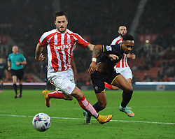Southampton's Nathaniel Clyne is out muscled - Photo mandatory by-line: Dougie Allward/JMP - Mobile: 07966 386802 - 29/10/2014 - SPORT - Football - Stoke - Britannia Stadium - Stoke City v Southampton - Capital One Cup - Fourth Round