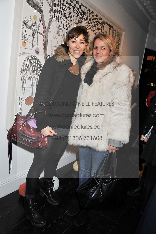Left to right, ZOE GRACE and LISA MOORISH at a private view of art works by Annie Morris entitled 'There is A Land Called Loss' held at Pertwee Anderson & Gold Gallery, 15 Bateman Street, London W1 on 2nd February 2012.