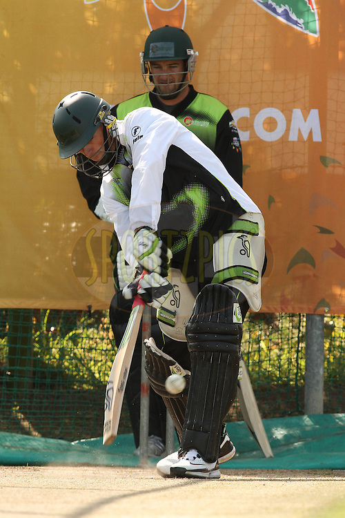 Davy Jacobs of the Warriors plays a delivery towards the legside as Mark Boucher of the Warriors looks on during the Warriors training session held at St Georges Park in Port Elizabeth on the 16 September 2010..Photo by: Shaun Roy/SPORTZPICS/CLT20
