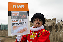 © Licensed to London News Pictures. 06/02/2019. London, UK.  An actor dressed as a Beefeater for the GMB Union protests outside the Tower of London this afternoon. GMB union members working for Historic Royal Palaces (HRP) are striking today at the Tower of London over the closure of their pension scheme. Photo credit: Vickie Flores/LNP