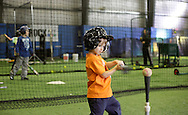 Chester, New York - A boy takes a swing in a batting cage during the first anniversary open house celebration at The Rock Sports Park on Nov. 12, 2011.