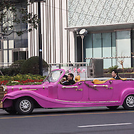 China, Shanghai.  pink car for wedding