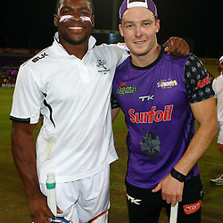 Durban South Africa -  December 15, S'bura Sithole with David Miller of the Sunfoil Dolphins during Hollywood Bets Showdown At The Coast - Sunfoil Dolphins vs CellC Sharks Match at the Kingsmead.Sahara Stadium Kingsmead (Photo by Steve Haag)images for social media must have consent from Steve Haag
