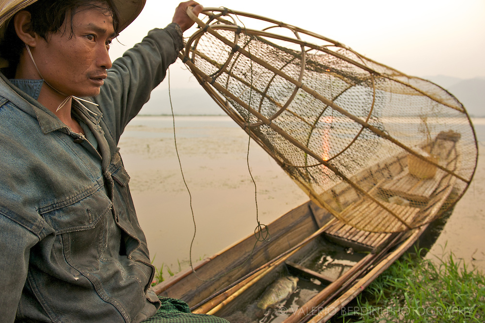Leg-rowing in a standing position allow the fisherman to see through the floating plants that grow all over the lake.