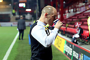 Norwich City manager Alex Neil drinking during the EFL Sky Bet Championship match between Brentford and Norwich City at Griffin Park, London, England on 31 December 2016. Photo by Matthew Redman.