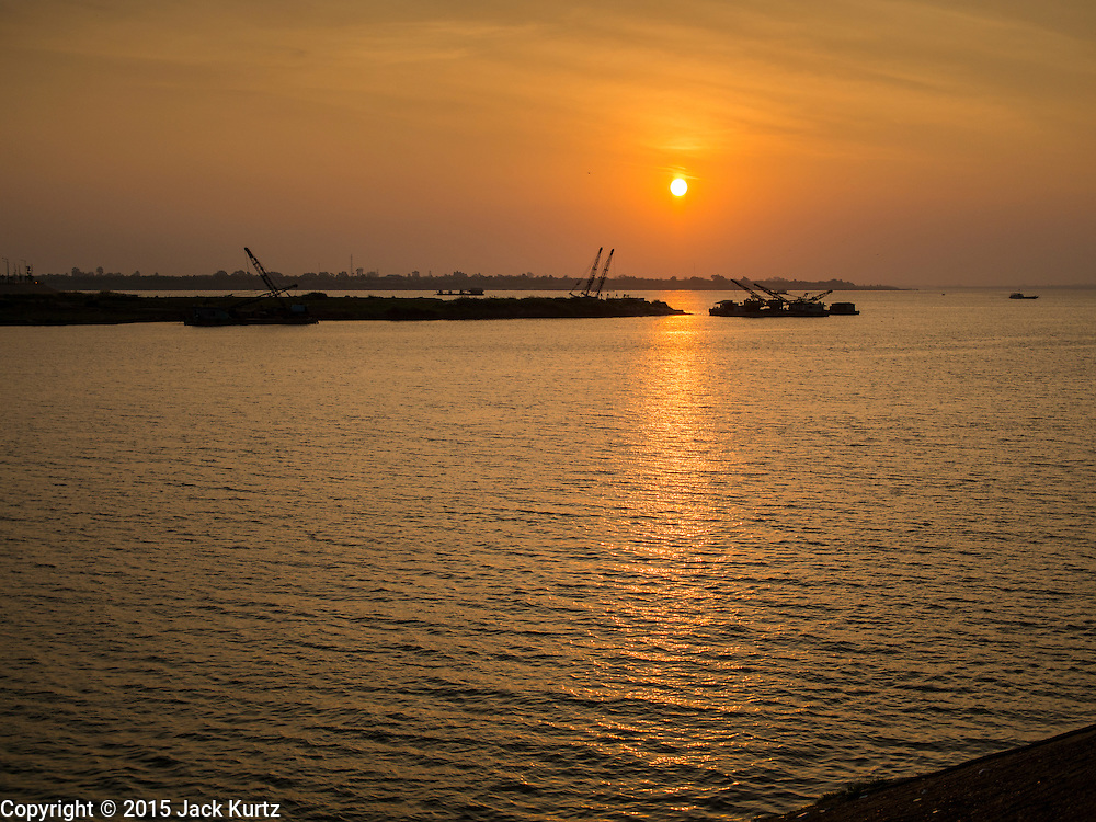 24 FEBRUARY 2015 - PHNOM PENH, CAMBODIA: Sunrise in Phnom Penh, the capital of Cambodia. The Tonle Sap River is in the foreground, the Mekong River in the background.    PHOTO BY JACK KURTZ
