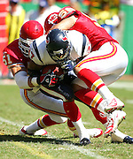 KANSAS CITY, MO - SEPTEMBER 26:  Running back Domanick Davis #37 of the Houston Texans runs into linebackers DaShon Polk #51 and Jay Foreman #56 of the Kansas City Chiefs at Arrowhead Stadium on September 26, 2004 in Kansas City, Missouri. The Texans defeated the Chiefs 24-21. ©Paul Anthony Spinelli *** Local Caption *** Domanick Davis, DaShon Polk, Jay Foreman