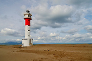 Lighthouse in El Fangar Beach, Tarragona. Catalonia, Spain.