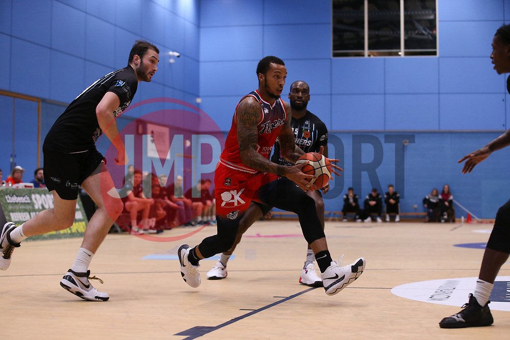 Gentry Thomas of Bristol Flyers drives at the Surrey Scorchers defence - Photo mandatory by-line: Arron Gent/JMP - 02/11/2019 - BASKETBALL - Surrey Sports Park - Guildford, England - Surrey Scorchers v Bristol Flyers - British Basketball League Cup