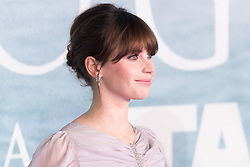© Licensed to London News Pictures. 13/12/2016. FELICITY JONES attends the launch of Rogue One: A Star Wars Story. The film follows a group of unlikely heroes banding together on a mission to steal the plans to the Death Star, the Empire's ultimate weapon of destruction. This key event in the Star Wars timeline brings together ordinary people who choose to do extraordinary things, and in doing so, become part of something greater than themselves. London, UK. Photo credit: Ray Tang/LNP