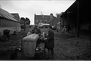 06-10/04/1964.04/06-10/1964.06-10 April 1964.Views on the River Shannon. Tom Reid (right) Chats with a fellow farmer at his farm at Killanure House at Glasson north of Athlone. One of the walls of the house was part of a Dillon Castle.