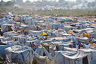 People living in a tent city in Port-au-Prince after the earthquake hit Haiti. Over one million people were displaced  after the earthquake and ended up creating tent cities. The temporary shelter provided by tent cities are not hurricane proof leaving Haitians in a state of danger.