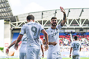 Leeds United midfielder Mateusz Klich (43) reacts to Leeds United forward Patrick Bamford (9) scoring a goal to make the score 0-2 during the EFL Sky Bet Championship match between Wigan Athletic and Leeds United at the DW Stadium, Wigan, England on 17 August 2019.