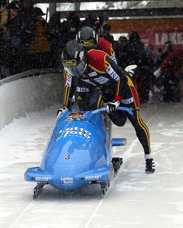 The Germany-1 bobsleigh team of pilot Andre Lange and Kevin Kuske jump into their sled after the push as they make their first run with a time of 56.95 for first place during the 2 Man Bobsleigh World Cup 29 November, 2003 in Lake Placid, NY. EPA/Andrew GOMBERT