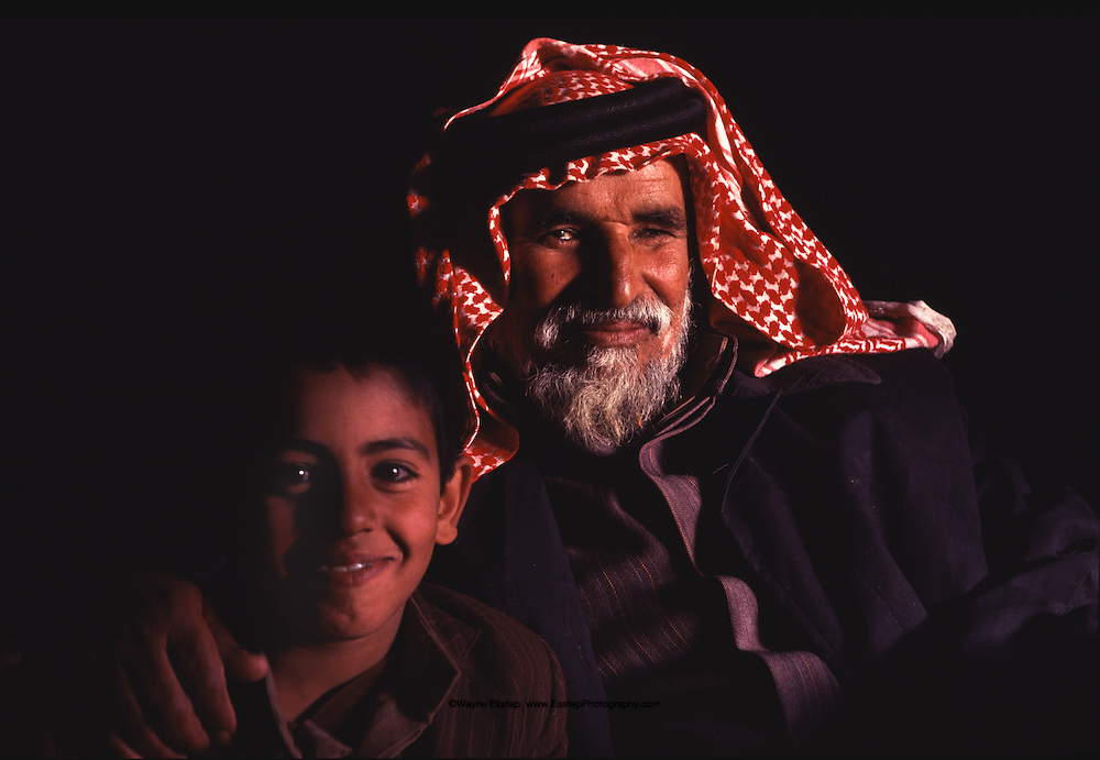 Naser bin Zaid Al Murrah and Ali bin Marrie Al Murrah have the benefit and pleasure of each other's company. Bedouin encampment in the Dahana Sands, Saudi Arabia