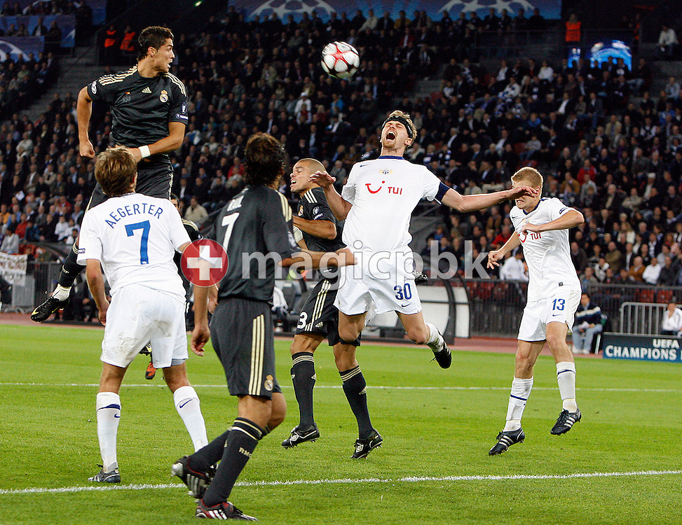 FC Zuerich defender Hannu Tihinen, center right no. 30, and Real Madrid defender Pepe, center left, battle for the ball during to the UEFA Champions League Group C soccer match between Switzerland's FC Zurich and Spain's Real Madrid at the Letzigrund Stadium in Zurich, Switzerland, Tuesday, Sept. 15, 2009. (Photo by Patrick B. Kraemer / MAGICPBK)