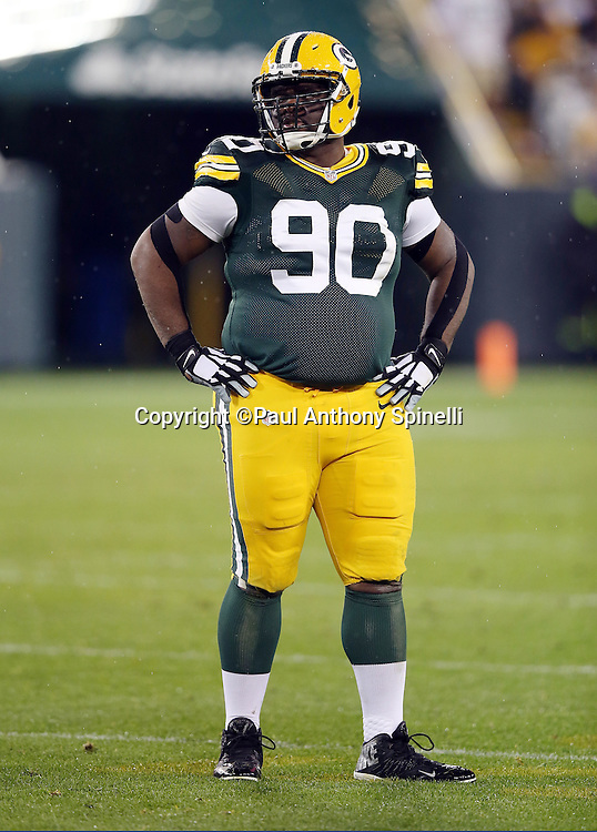 Green Bay Packers nose tackle B.J. Raji (90) looks on during the 2015 NFL week 3 regular season football game against the Kansas City Chiefs on Monday, Sept. 28, 2015 in Green Bay, Wis. The Packers won the game 38-28. (©Paul Anthony Spinelli)