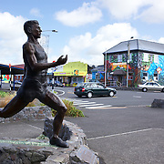 A larger than life-size bronze statue of Olympic runner and Gold Medalist Peter Snell  in his hometown of Opunake, Taranaki. The statue is based on a photo of Snell crossing the finish line in the historic race at Wanganui's Cook's Gardens in 1962. Opunake, New Zealand,, 23rd December 2010.  Photo Tim Clayton
