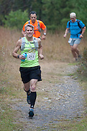Kerhonkson, New York - Don Weise leads a group of runners through Minnewaska State Park Preserve during the Shawangunk Ridge Trail Run/Hike 20-mile race on Sept. 20, 2014.