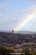 Sheffield, UK 19 Oct 2014: Rainbow over the city strikes Sheffield University Arts Tower on 19 Oct 14 from Meersbrook Park