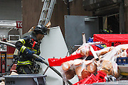 April 4, 2014 - New York, NY. Fire fighters confront a fire that erupted at a Burger King in the Financial District in Manhattan. No one was reported injured, said FDNY Assistant Chief John Sudnick. 04/04/2014 Photograph by Rachael Levy/NYCity Photo Wire