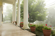 Columns and pots of geraniums on Richard Ballinger's front porch in Rensselaerville, New York, U.S.A.