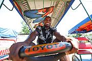 Cyclo taxi driver at Mahanaro market. . Madagascar. Photo - Zute Lightfoot)
