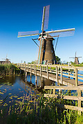 Walkway to group of authentic windmills at Kinderdijk UNESCO World Heritage Site, polder, ducks on dyke, Holland