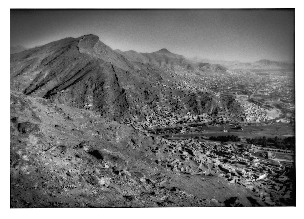 Looking down over a landmined mountainside to Kabul, Afghanistan.