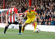 Rotherham United defender (and former Brighton player) Joe Mattock looks to take on Brentford forward Sergi Canos during the Sky Bet Championship match between Brentford and Rotherham United at Griffin Park, London, England on 17 October 2015. Photo by Andy Walter.