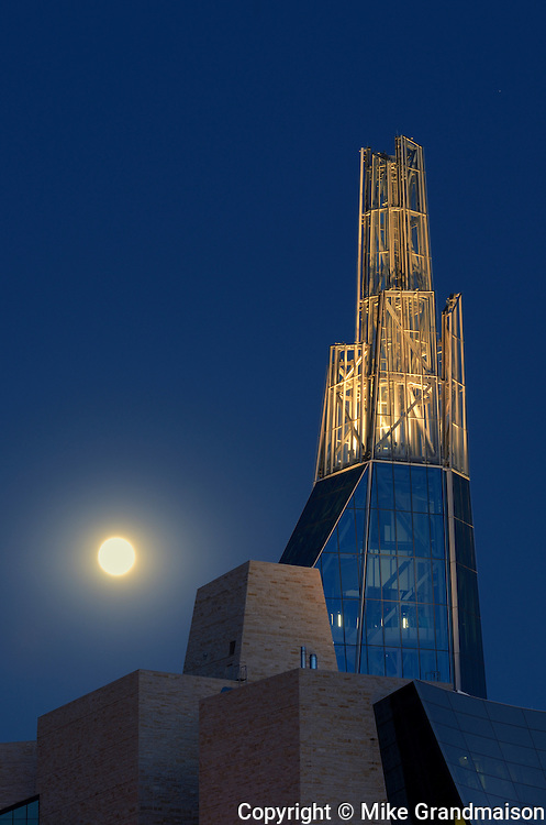 Canadian Museum for Human Rights (CMHR) with full moon rising<br /> Winnipeg<br /> Manitoba<br /> Canada