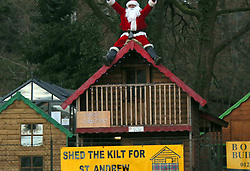 Farnham,Surrey Friday 1st December 2017  There are Christmas job and there are Christmas job but this one takes the biscuit. Sit out in the freezing cold on top of a shed roof on the busy A31 Farnham By pass roundabout waving at drivers. Yep you got it  that the job of this guy dressed in a Santa Suit for the next 24 Days between the  working hours of 8am and 4pm. Come rain or shine frost or snow.  The normally congested roundabout of driver attempting to get to work was filled with a bit of Christmas joy on the 1st Day  of the big build up to Christmas. Santa was waving to passing drivers who intern returned with a sounding of the horn.©UKNIP