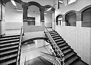Nederland, Arnhem, 2-1-2015De trappen in het trappenhuis van de HBS  waar  M.C. Escher naar school ging vormeden een inspiratie voor zijn latere werk. De school, een rijksmonument met invloeden van Berlage, het Rationalisme en Art Nouveau, bevat een trappenhuis dat een opvallende gelijkenis vertoont met de prenten met trappen en labyrinten die Escher maakte. Ook de pseudo-romaanse doorgangen en de wit betegelde muren zijnn hier onderdeel van. Het gebouw is nu bewoond en niet toegangkelijk voor publiek.The stairs in the stairwell of the school where artist MC Escher went to school formed an inspiration for his later work. The school, a national monument influenced by Berlage, Rationalism and Art Nouveau, includes a staircase that bears a striking resemblance to the prints made with stairs and labyrinths by Escher. The building is now a residence with appartments and inaccessible to the public.FOTO: FLIP FRANSSEN/ HOLLANDSE HOOGTE