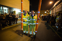 @Licensed to London News Pictures 29/11/2014. Dartford Crossing, South Orbital Road, Dartford, Kent. Booth operators holding some of the redundant barriers at the Dartford Crossing. The first phase of barrier removals start in the early hours of today 29/11/2014. Payment booths at the Dartford Crossing will be removed and replaced with a remote charging system known as Dart Charge. Photo credit: Manu Palomeque/LNP