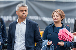 © Licensed to London News Pictures. 12/06/2016. London, UK.  Sadiq Khan, recently elected Mayor of London, accompanied by his wife, greets large numbers of people gathered in Trafalgar Square, despite heavy rain, for the Mayor of London's Patrons Lunch in celebration of The Queen's official 90th birthday. Photo credit : Stephen Chung/LNP