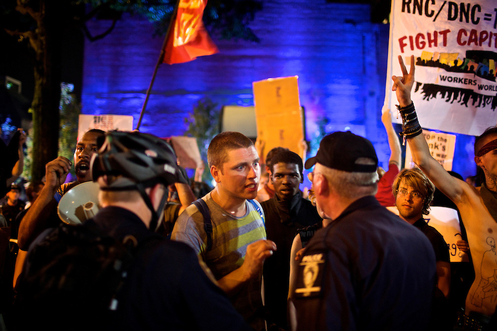 Members of the Occupy Wall Street movement argue with police at a march in Charlotte, N.C. during the 2012 Democratic National Convention on Sept. 6, 2012.