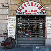 An antique shop and bike in Verona..Verona is a city in Veneton, Northern Italy home to approx. 265,000 inhabitants and one of the seven provincial capitals of the region. Verona has Roman origins and  derived importance from being at the intersection of many roads. It is world famous for the Arena and its Opera....***Agreed Fee's Apply To All Image Use***.Marco Secchi /Xianpix. tel +44 (0) 207 1939846. e-mail ms@msecchi.com .www.marcosecchi.com
